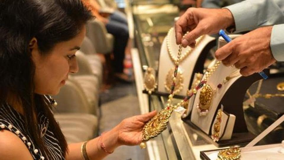 A shopper looks for gold jewellery and ornaments during Dhanteras at a jewellery store in Amritsar on October 17, 2017.