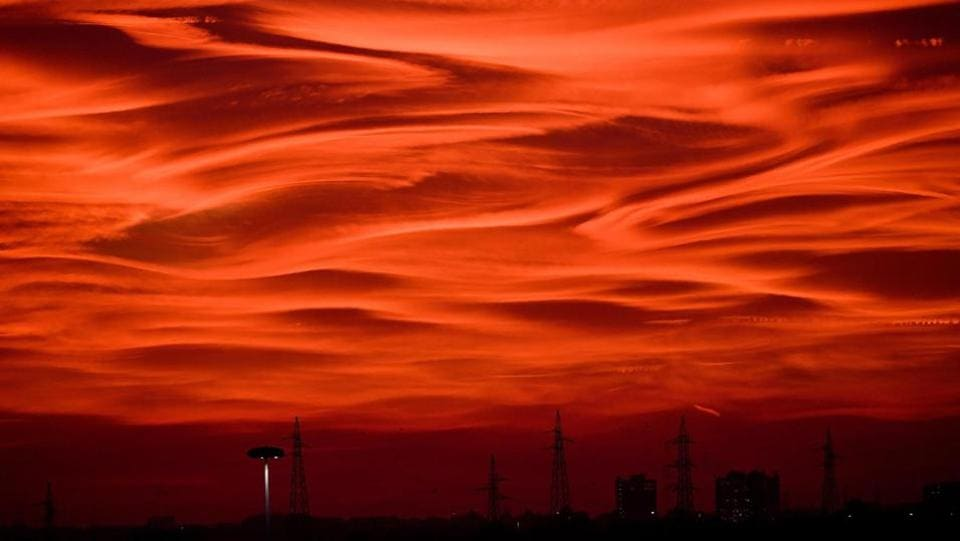 Over the last weekend silhouettes of electricity pylons and buildings contrast on a fire-red sunset, as the autumn darkness falls over Milan. As winter knocks on the door here is look at autumn's passing beauty round the world. (Daniel Dal Zennaro / AP)