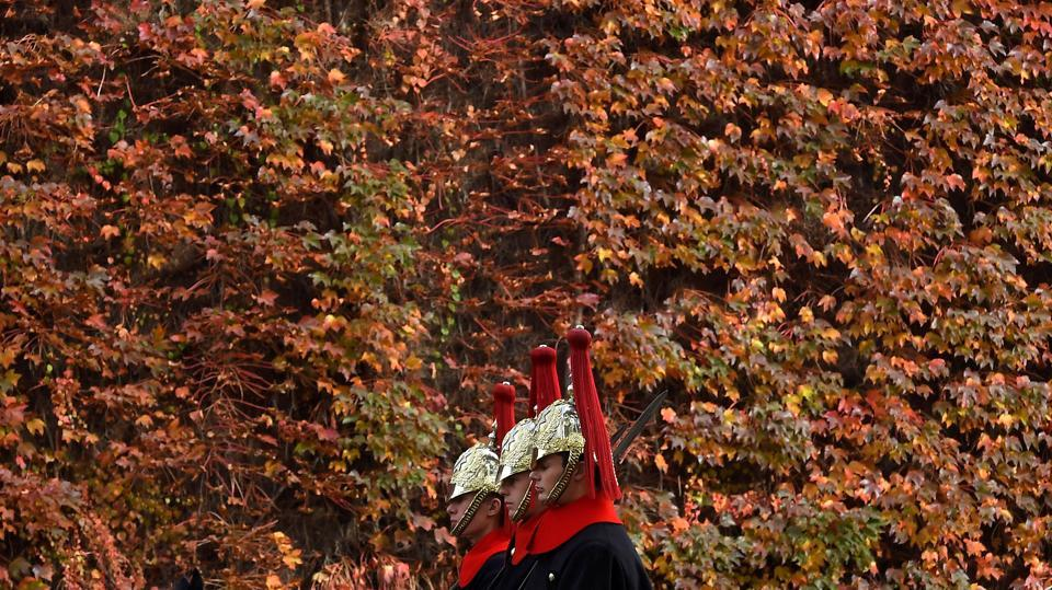Members of the Household Cavalry ride past autumn foliage in central London, Britain. Nature, with its various shades of red, yellow, orange and brown, provides moments of infinite calm. (Toby Melville / REUTERS)