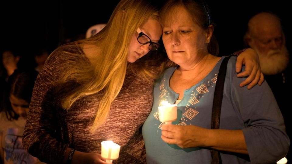 People attend a candle light vigil after a mass shooting at the First Baptist Church in Sutherland Springs, Texas on November 5, 2017. A gunman dressed in black tactical gear killed at least 26 people and wounded 20 others at a white-steepled church in Texas on Sunday, carrying out the latest in a series of mass shootings that have plagued the United States. (Sergio Flores / REUTERS)