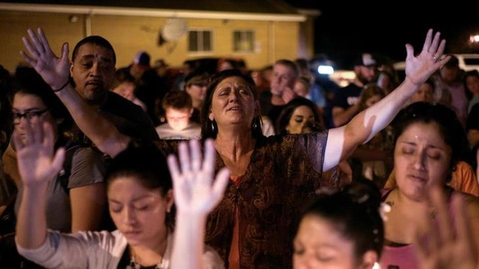 Residents attend a vigil after the mass shooting at the First Baptist Church in Sutherland Springs, Texas. The church, of the protestant First Baptist Church was a place for friends to gather and meet every weekend. (Sergio Flores / REUTERS)