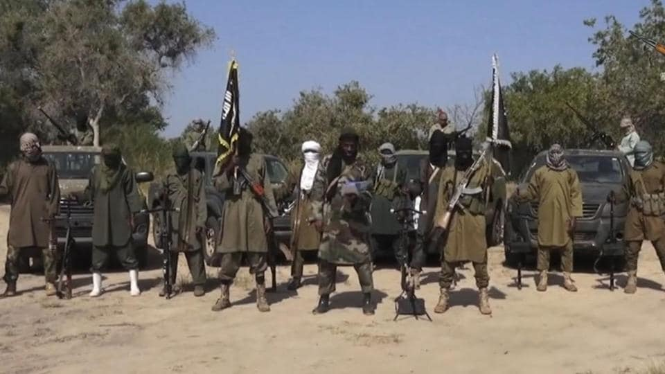 Abubakar Shekau, centre, the leader of Nigeria's Islamic extremist group, surrounded by his fighters on Oct. 31, 2014.