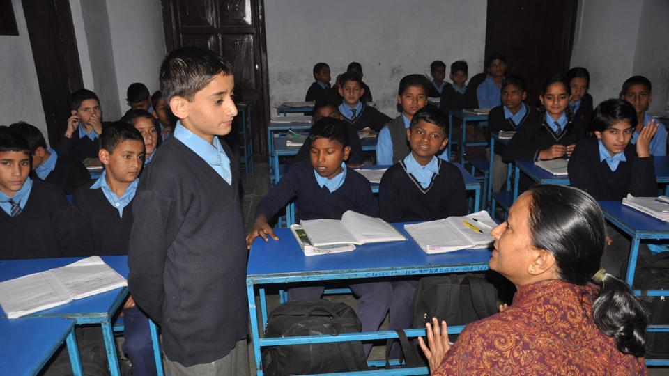 Principal secretary Radha Raturi (right) interacts with students at the government school.