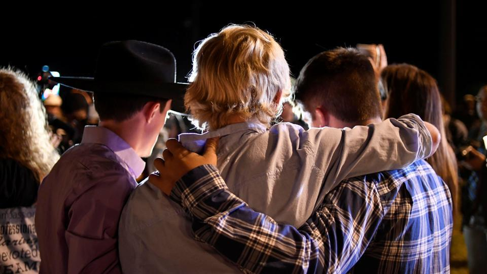 Local residents embrace during a candlelight vigil for victims of the shooting. Sutherland Springs is a small rural community of about 680 people --residents told reporters it was a place where nothing ever happened and everyone knew everyone. (Mohammad Khursheed / REUTERS)
