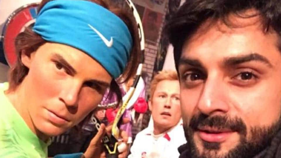 Actor Karan Wahi with the wax statue of tennis star Rafael Nadal at the Madame Tussauds Wax Museum in London.