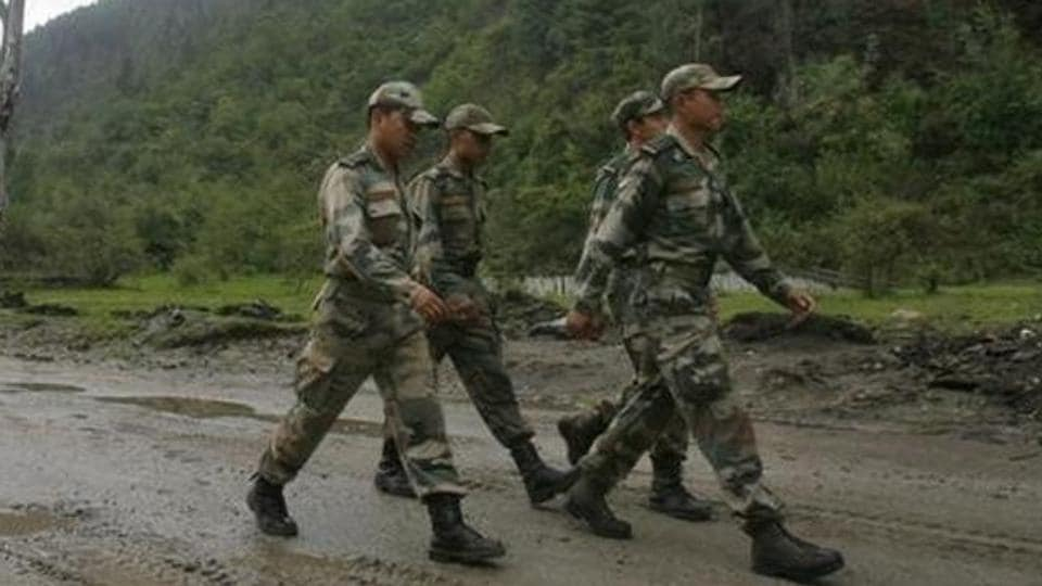Indian army soldiers march near an army base on Tezpur-Tawang highway.