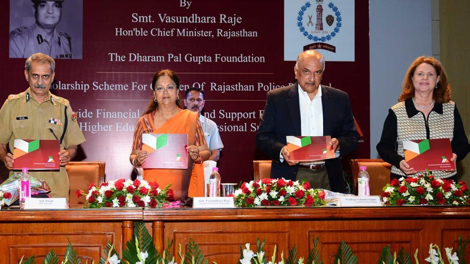 Pradeep Yohanne Gupta (centre) and his wife Linda Haynes (right) with Rajasthan chief minister Vasundhara Raje and DGP Ajit Singh Shekhawat (left) during the launch of the Dharam Pal Gupta Foundation, at the Rajasthan Police Academy in Jaipur on Sunday.
