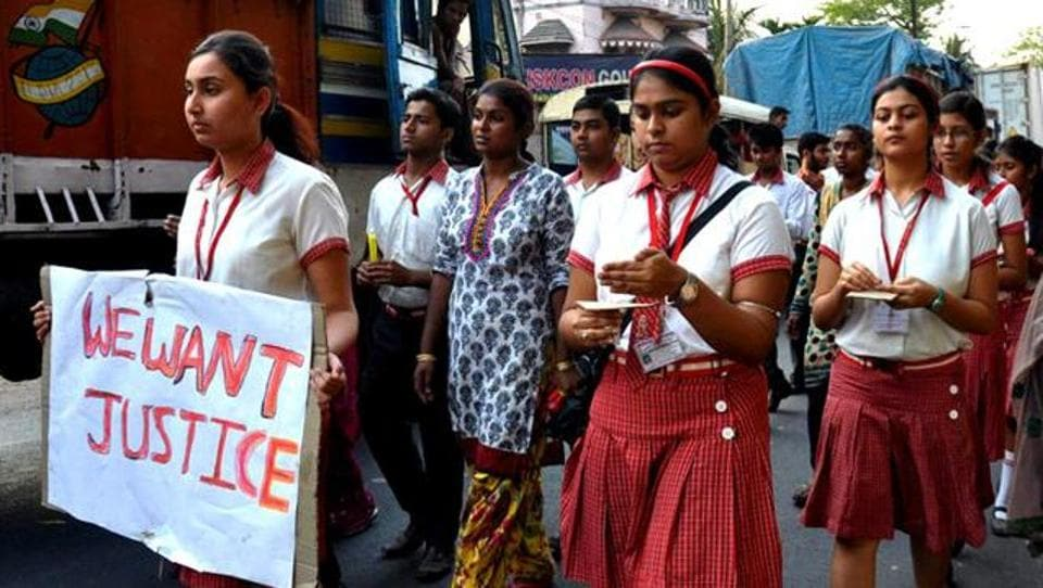 Students from the Convent of Jesus and Mary in Ranaghat protest after the rape of a 71-year-old nun  at the convent. AFP FILE Photo