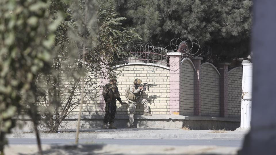 Afghan security personnel take position near the Shamshad TV station after an attack in Kabul, Afghanistan, on Tuesday.