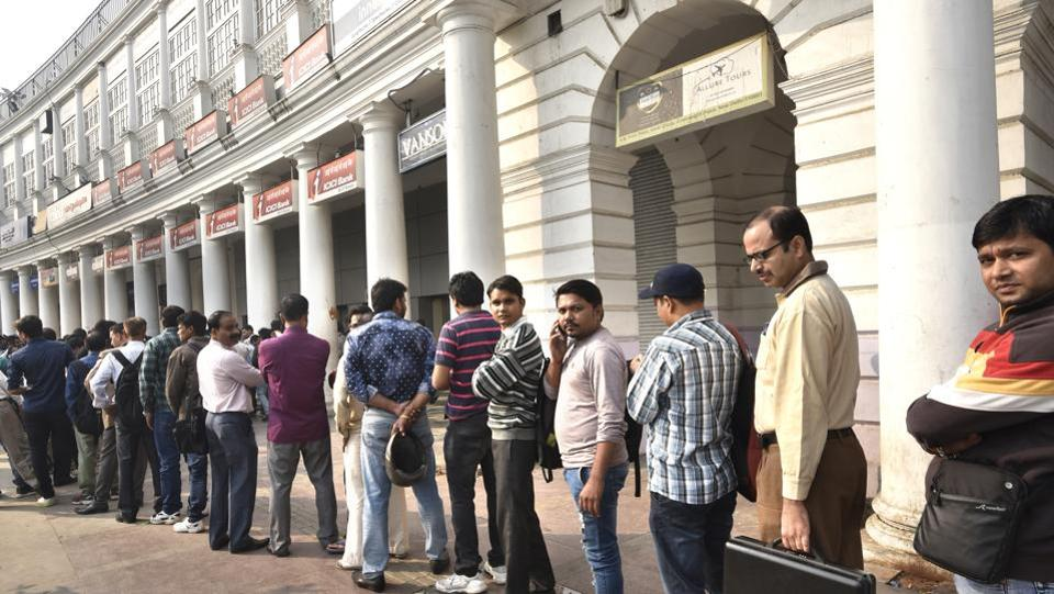Connaught Place has several bank and ATM branches, yet there was no respite from serpent-like queues last November. Demonetisation was projected as part of a broader push to promote digitization and non-cash payments. (Arvind Yadav / HT Photo)