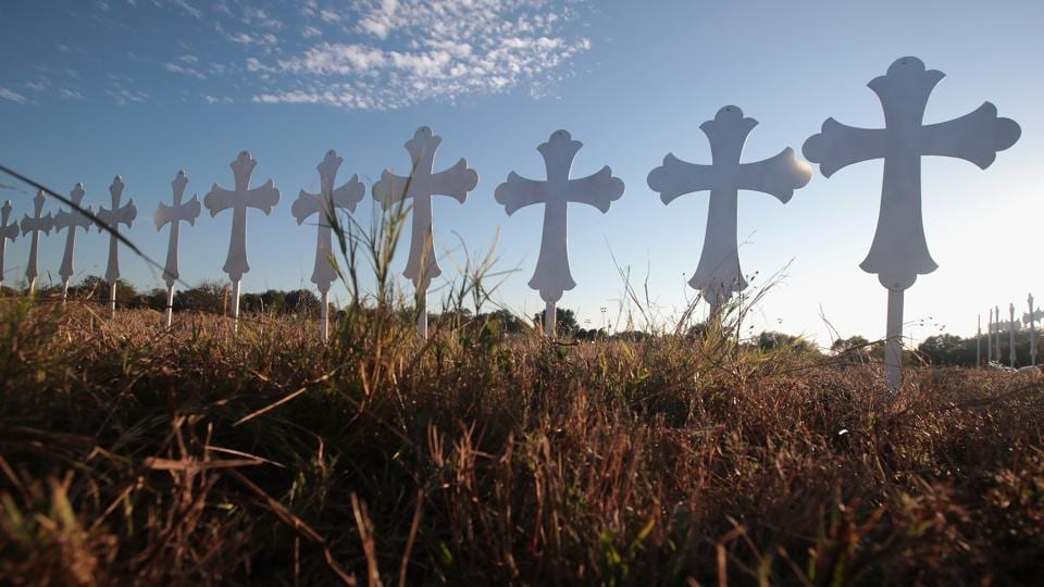 Crosses in a field on the edge of Sutherland Springs, Texas honour the 26 people killed at the town's First Baptist Church on Sunday.