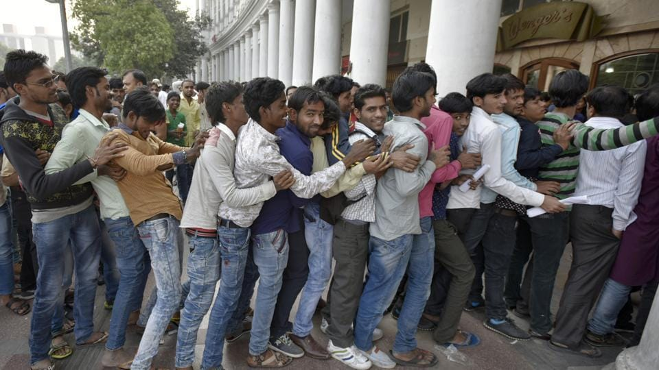 People stand in queue outside a bank in Connaught Place in New Delhi, November 2016. A year ago, Prime Minister Narendra Modi announced the scrapping of high-value banknotes which amounted to 86% of currency in circulation. (Ravi Choudhary / HT Photo)
