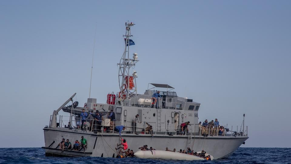 The Libyan Coast Guard tries to recover migrants from a rubber dinghy in the Mediterranean Sea on Monday.