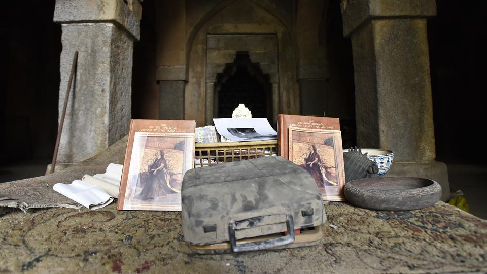 A three-page note with several handwritten accounts now lies scattered on the premises with other belongings of the family, including several pairs of old shoes, a broken typewriter, porcelain crockery, cups, copper vessels and  soiled carpets.  (Sanchit Khanna / HT Photo)