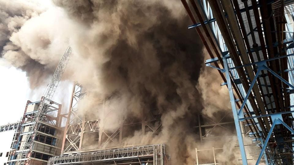 Smoke billows from a coal-fired power plant  of the NTPCin Unchahar in UP's Rae Bareli  district after a boiler unit exploded on November 1.