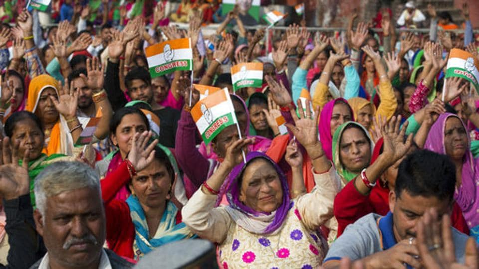 Supporters shout slogans as they wait for Congress party vice president Rahul Gandhi, to arrive an election rally in Nagrota, 40 km south of Dharamsala.