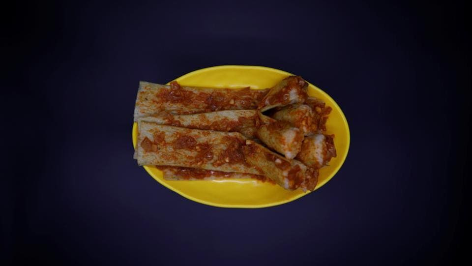 Like dububab, injogigibab is a North Korean street food. It is made of the residue left over from making soybean oil, dried and sold in reels, and stuffed with rice. The topping depends on the region. Some prefer a fish-based sauce, others use chilli paste. Bab means rice, and injogogi means 'man-made meat.' In North Korea, for years it was a recipe for survival. Today it is a popular street food. (Kim Hong-Ji / REUTERS)