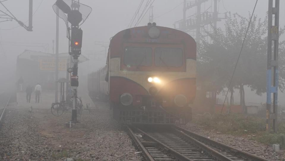 A train from Jalandhar to Pathankot finding its way amid dense fog in Jalandhar on Tuersday.   (Pardeep Pandit/HT )