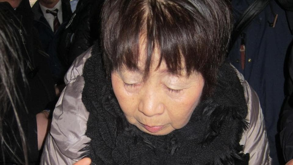 File photo shows Japanese woman Chisako Kakehi, arrested on suspicion of poisoning her husband with cyanide in the Black Widow case, arrives at the Kyoto district court.