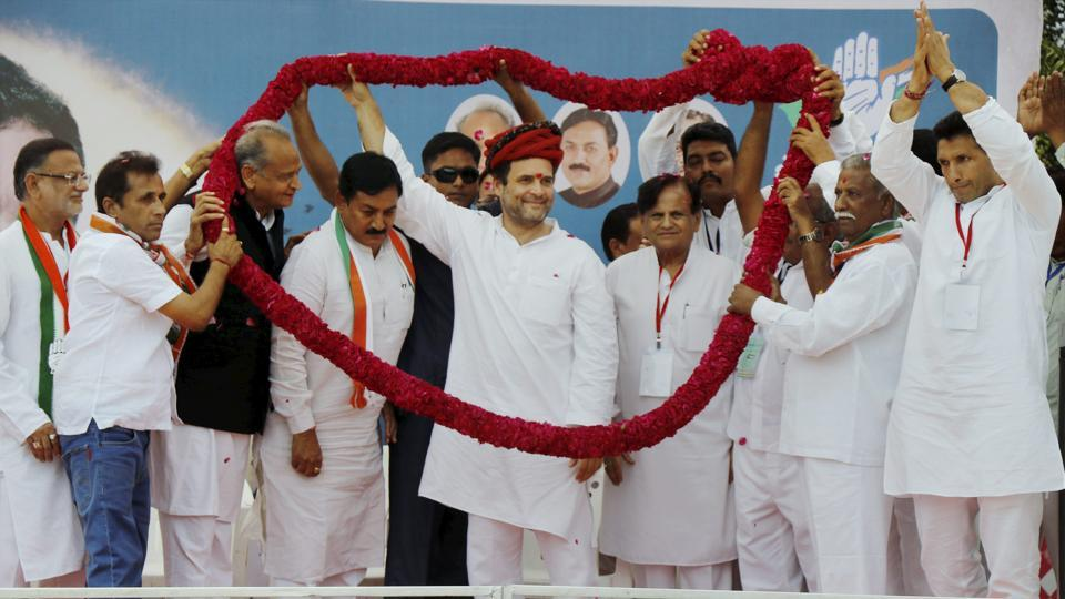 Congress workers felicitate party vice-president Rahul Gandhi during a public meeting in Kheda district, Gujarat.
