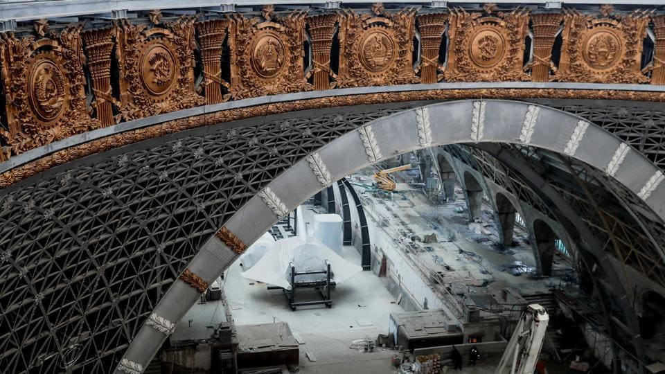 Cosmos Pavilion under reconstruction at the Exhibition of Achievements of National Economy in Moscow. The coat of arms of the USSR, of the 15 former Soviet republics and the emblems of the sectors of the economy were found at the base of the dome of the pavilion behind false panels during restoration work. (Maxim Shemetov / Reuters)