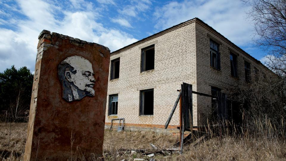 A panel with a portrait of Vladimir Lenin and an abandoned building are seen at the 30km exclusion zone around the Chernobyl nuclear reactor in the abandoned village of Orevichi, Belarus. When he died in 1924, Soviet authorities displayed his embalmed body in a mausoleum in Moscow's Red Square where it lies to this day. (Vasily Fedosenko / REUTERS)