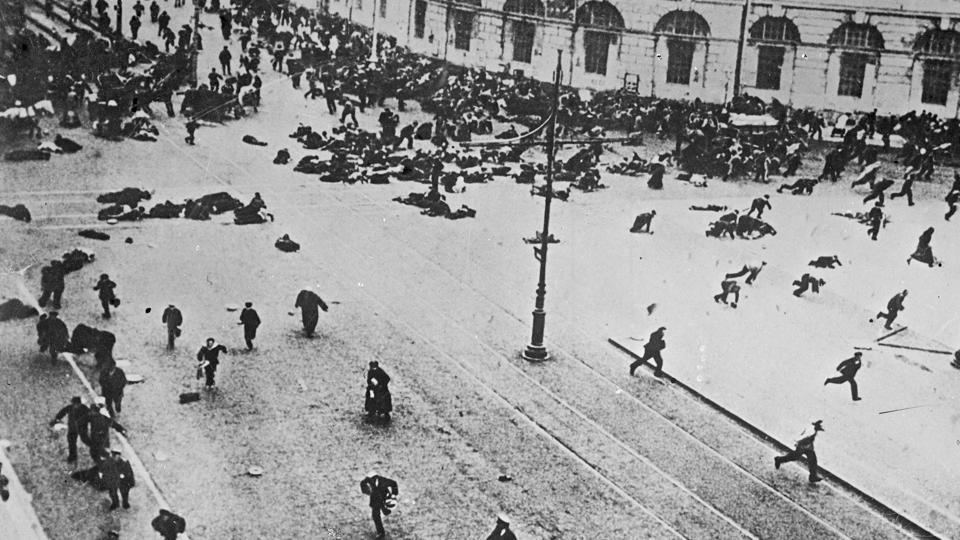 Russian troops fire on demonstrators with machine guns, on the corner of Nevsky Prospect and Sadovaya Street, in St.Petersburg on July 4, 1917. In the strife of this environment, soldiers and industrial workers of the Petrograd Soviet, a centre of opposition to the Provisional Government and backed by the Bolsheviks emerged in spontaneous demonstrations over what came to be known as the July Days. (Karl Bulla Historical Foundation via AP)