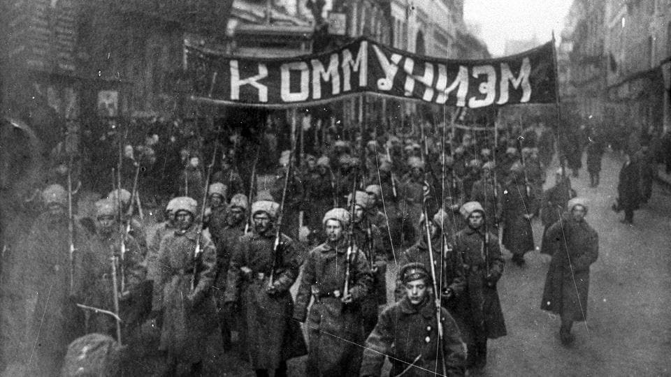 Armed soldiers carry a banner reading 'Communism' as they march along Nikolskaya Street towards to the Kremlin Wall in Moscow, Russia. In a counter to Bolshevik appeals, Commander-in Chief General Lavr Kornilov marched with troops to restore order in Petrograd but the movement was halted by the Bolshevik influence on railroad and telegraph workers.  (Russian State Documentary Film and Photo Archive via AP)