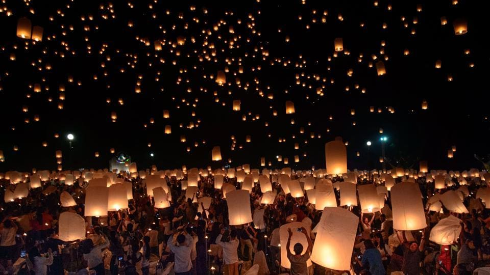 A crowd releases lanterns into air as they celebrate the Yee Peng festival, in Chiang Mai. This event in Northern Thailand pays respects to Buddha. (Reuben Easey / AFP)