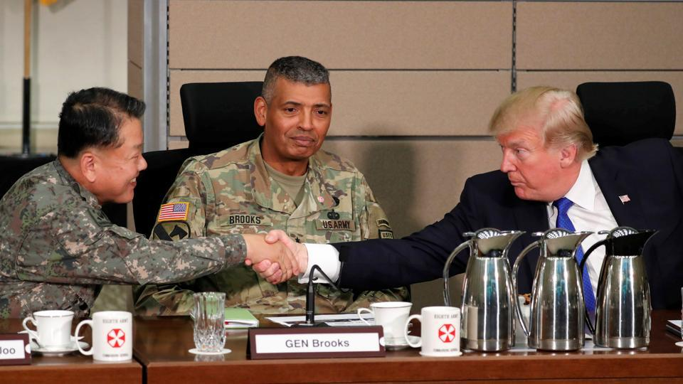 US President Donald Trump greets South Korea's General Kim Byeong-joo (L) and US Army General Vincent Brooks (C) as he arrives to receive a briefing from military commanders at the US Eighth Army Operation Command Center at US military installation Camp Humphreys in Pyeongtaek, South Korea, on Tuesday.