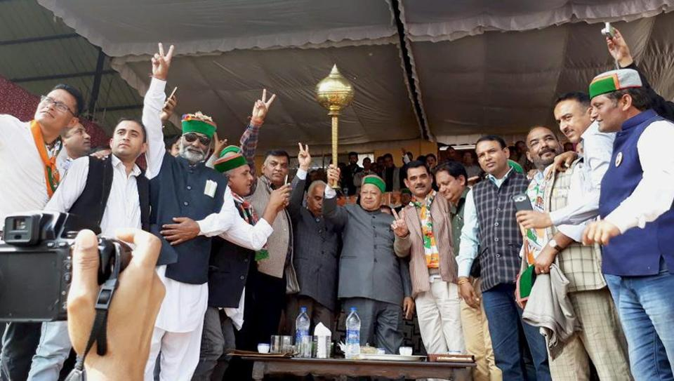 Himachal Pradesh chief minister Virbhadra Singh with supporters during an election rally at Kunihar in Shimla on Tuesday.