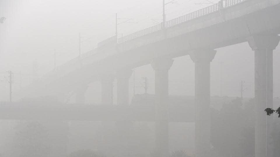 A dense blanket of fog envelops Dhaula Kuan in New Delhi.