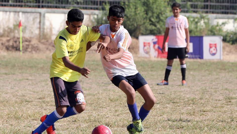 Bharati Vidyapeeth English Medium School (white bib) routed Bal Seva English Medium School 7-0 in the junior boys qualifier.