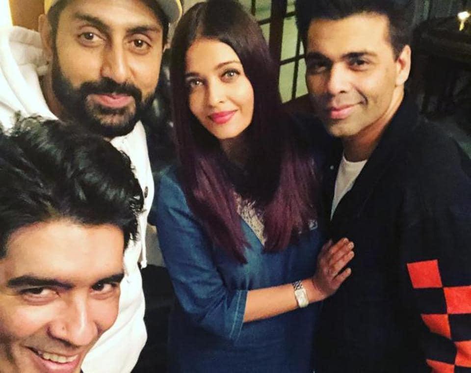 Manish Malhotra, Abhishek Bachchan, Aishwarya Rai and Karan Johar at the designer's party.