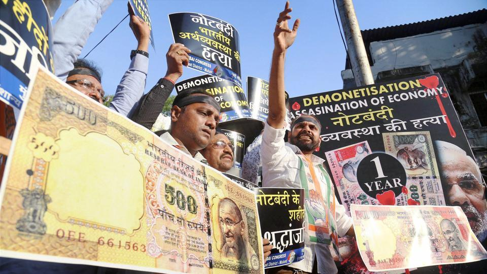 Congress workers stage a protest against the BJP government on the eve of the first anniversary of 'demonetisation' in Mulund, Mumbai.