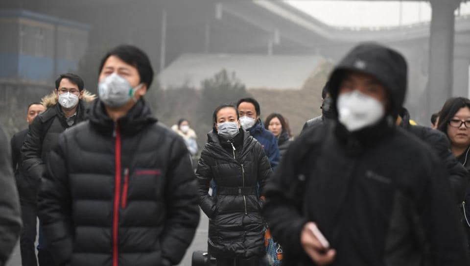 Commuters wear masks on a polluted day in Beijing. The government is looking at several ways to curb pollution in Beijing and its surrounding areas.