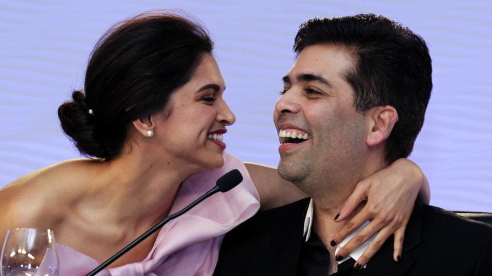 Actor Deepika Padukone hugs Bollywood producer Karan Johar during a session of the Hindustan Times Leadership Summit 2014 in New Delhi. (Gurinder Osan/HT FIle Photo)