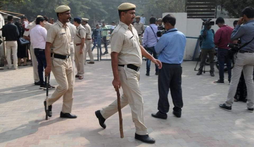 Policemen outside a juvenile court where the CBI produced on Wednesday a 16-year-old boy in connection with the murder of an eight-year-old student of Ryan International School, in Gurgaon on Wednesday.