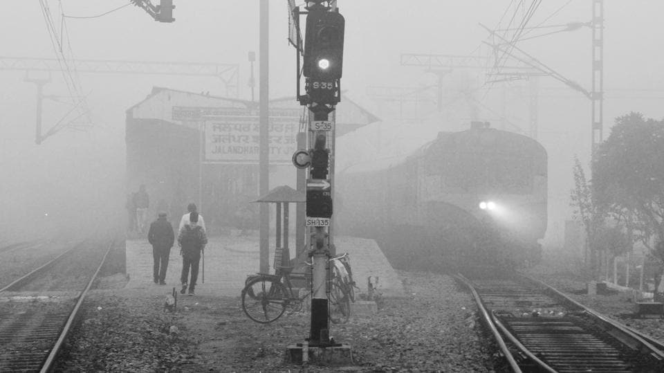 A train from Jalandhar to Pathankot emerges in the dense fog on November 07, 2017. While experts are still undecided about whether it's fog or smog that's engulfed most of north India, trains continued to be delayed.  (Pardeep Pandit / HT Photo)