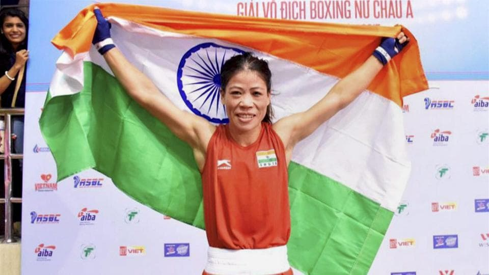 Mary Kom celebrates after winning her fifth Asian Boxing Championship gold medal in Ho Chi Minh City in Vietnam on Wednesday. (PTI)