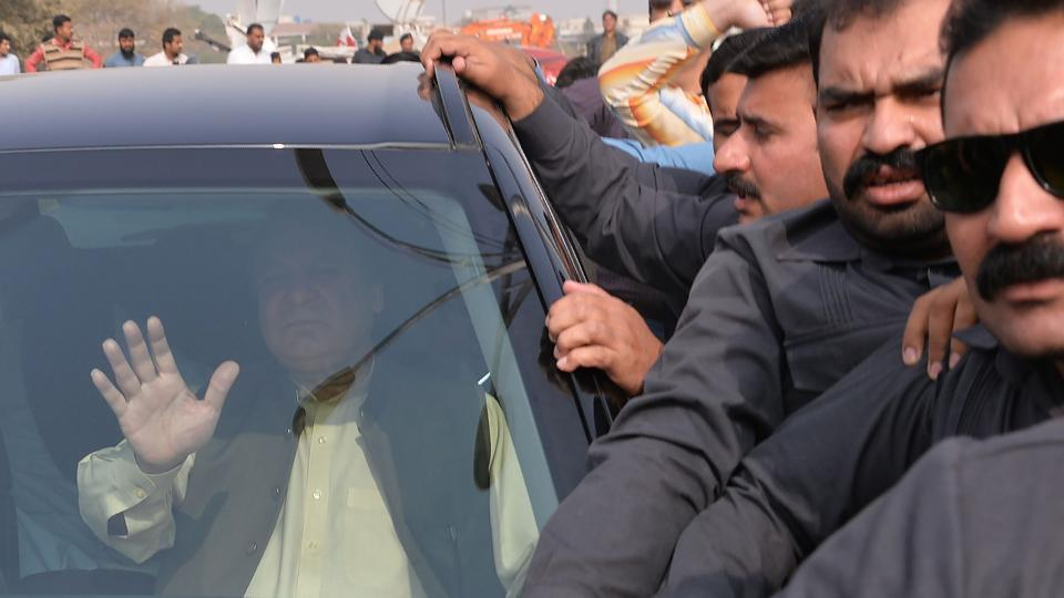 No way out: Ousted Pakistani prime minister Nawaz Sharif waves to supporters as he leaves an accountability court after a personal appearance to face corruption charges in Islamabad on Wednesday.