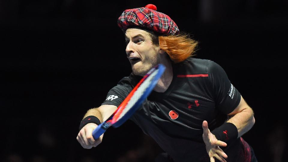 Andy Murray can be seen here wearing a tartan hat as he plays Roger Federer.  (AFP)