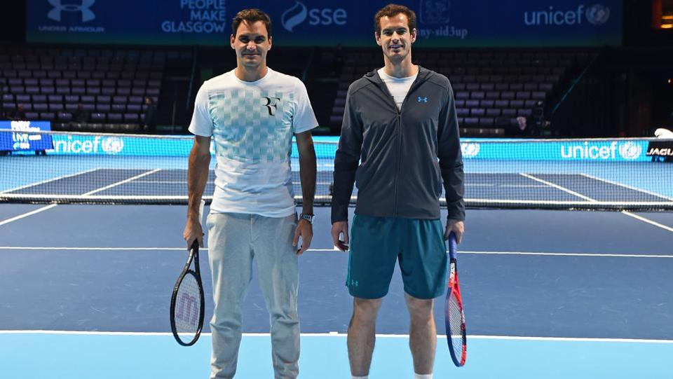 Roger Federer and Andy Murray pose for a photograph on court before their exhibition tennis event,