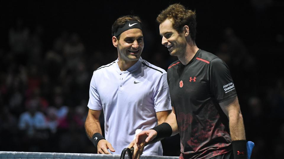 """Andy Murray chats with Roger Federer (L) after their exhibition tennis match during """"Andy Murray Live"""" at the SSE Hydro in Glasgow, Scotland.  (AFP)"""