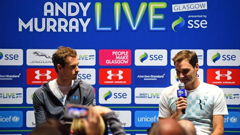 Roger Federer (R) and Andy Murray attend a press conference after the match.  (AFP)
