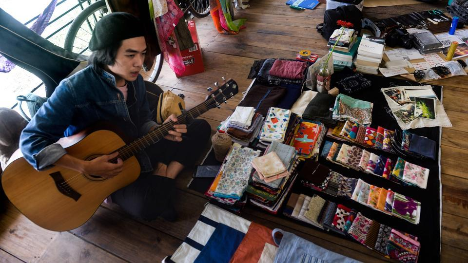 'Young people are more open-minded and they want to share deeply and widely to overcome pain, without suffering alone,' said founder Dinh Thang, as a visitor strummed love songs on a guitar nearby.  (Hoang Dinh Nam / AFP)