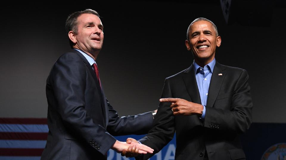 Former US President Barack Obama (right) gestures to Democratic candidate Ralph Northam during a campaign rally in Richmond, Virginia, last month.  Northam, a physician and Gulf War veteran, easily defeated Ed Gillespie, an establishment Republican figure, in the state elections.