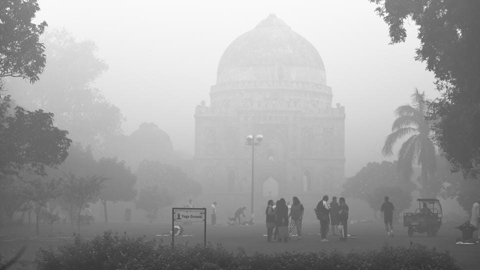 At the picturesque Lodhi Gardens in New Delhi, people seemed to care less if it was fog or smog, continuing with their morning routine.  (Sanchit Khanna / HT Photo)