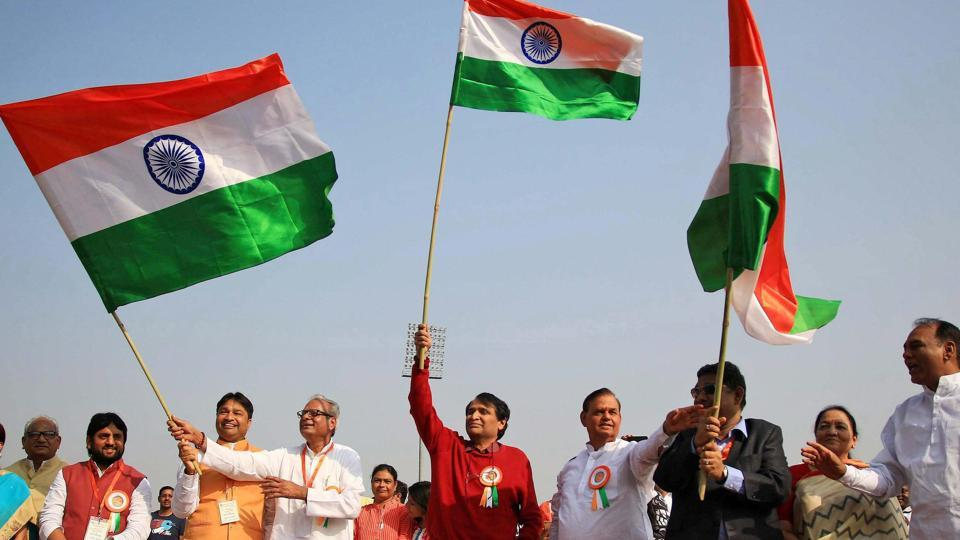 Union minister for commerce and industry Suresh Prabhu waves the tri-colour as he joins students and musicians participating in 'Voice of Unity' event at SMS Stadium in Jaipur on Wednesday.