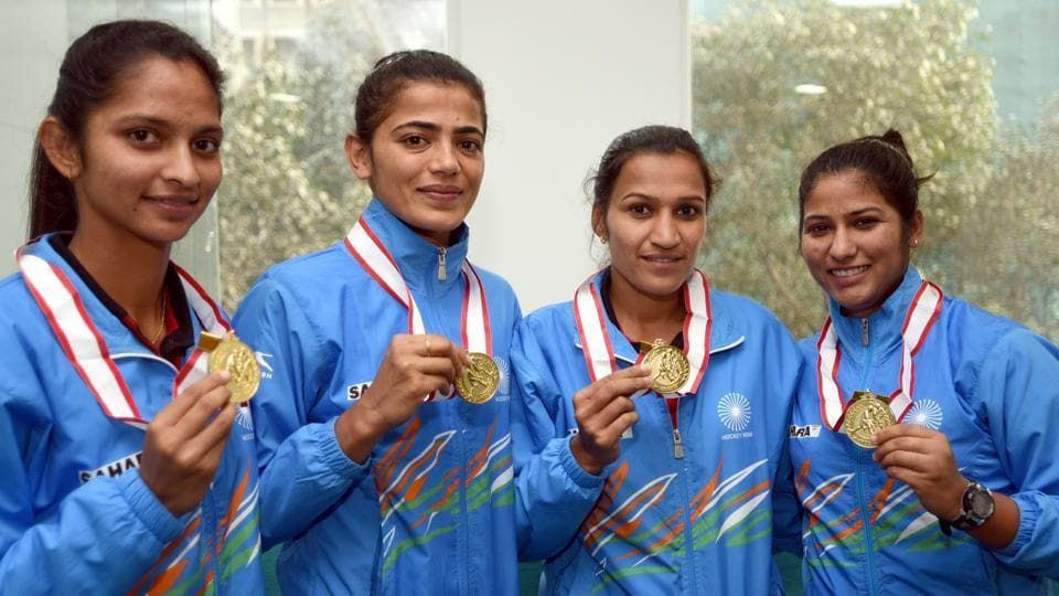Savita Punia (second from left) saved a crucial penalty for India against China in the Women's Asia Cup hockey final.